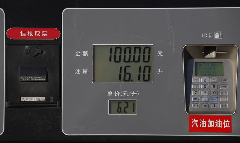 Fuel prices are seen displayed on a fuel pump at PetroChina's solar-powered Yizhuang gas station in Beijing