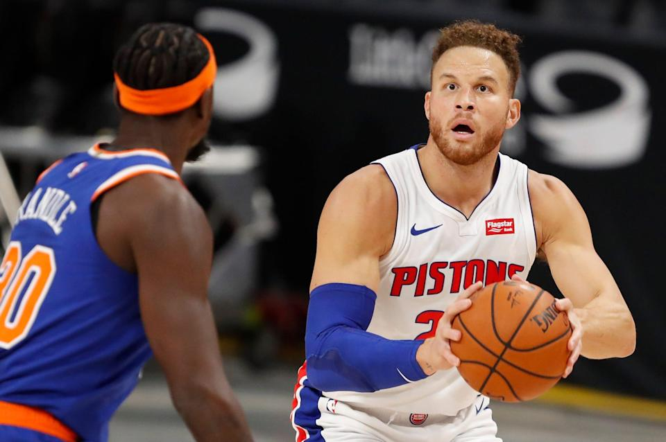 Detroit Pistons forward Blake Griffin is defended by New York Knicks forward Julius Randle during the preseason opener Dec. 11, 2020 at Little Caesars Arena.