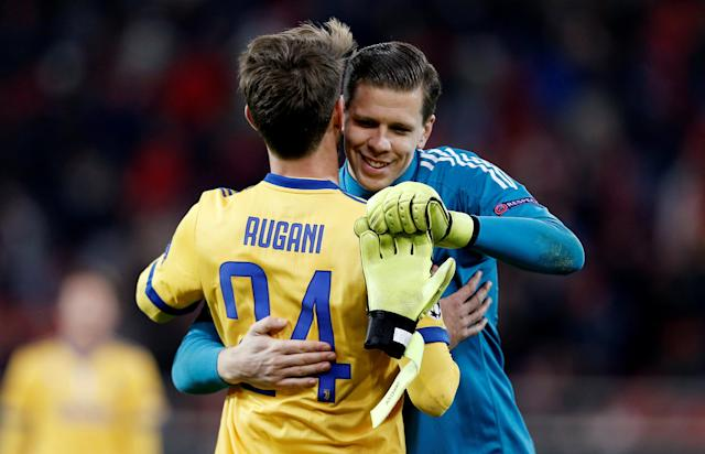 Soccer Football - Champions League - Olympiacos vs Juventus - Karaiskakis Stadium, Piraeus, Greece - December 5, 2017 Juventus' Daniele Rugani and Wojciech Szczesny celebrate after the match REUTERS/Costas Baltas