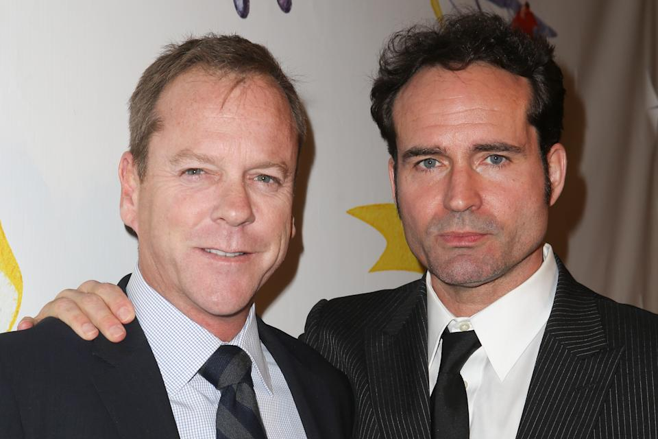 WEST HOLLYWOOD, CA - NOVEMBER 13:  Actors Kiefer Sutherland (L) and Jason Patric arrive at the