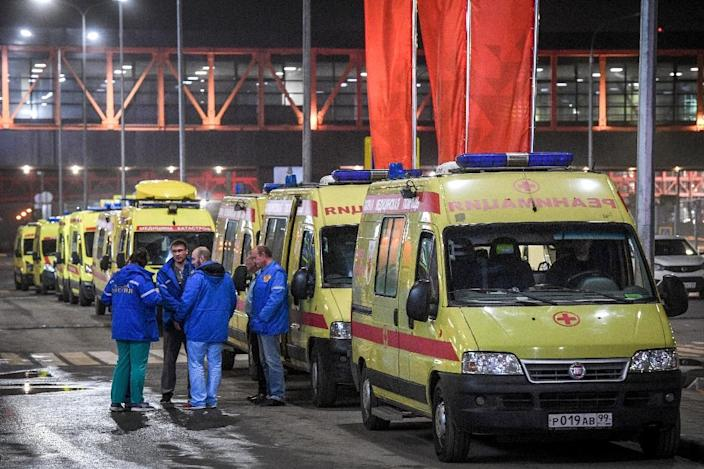Ambulances are parked in front of the terminal building of the Sheremetyevo Airport outside Moscow after a Russian-made Superjet-100 on fire attempted an emergency landing (AFP Photo/Kirill KUDRYAVTSEV)