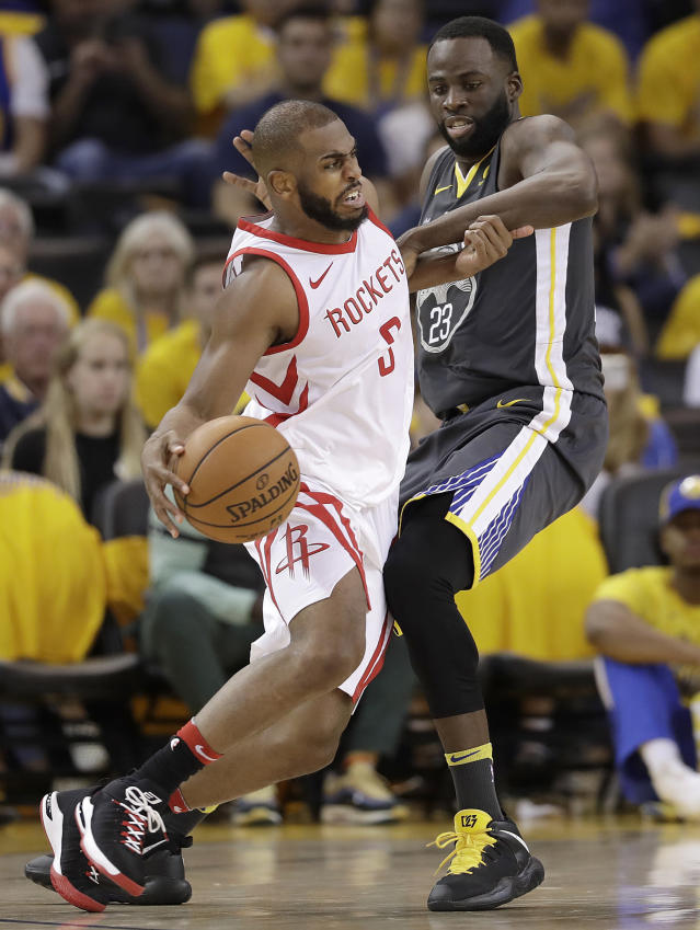 Houston Rockets guard Chris Paul, left, is defended by Golden State Warriors forward Draymond Green during the second half of Game 4 of the NBA basketball Western Conference Finals in Oakland, Calif., Tuesday, May 22, 2018. (AP Photo/Marcio Jose Sanchez)