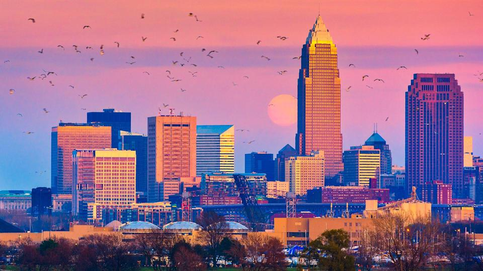 The December supermoon rises above Cleveland Ohio next to the cityâ??s tallest building.