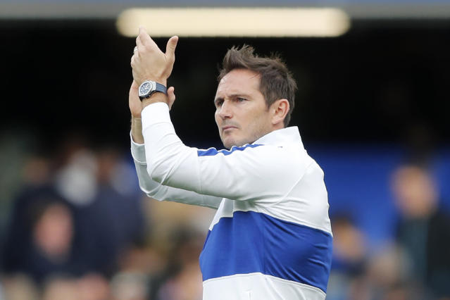 Chelsea's head coach Frank Lampard applauds the supporters at the end of the English Premier League soccer match between Chelsea and Leicester City at Stamford Bridge stadium in London, Sunday, Aug. 18, 2019. The match ended in a 1-1 tie.(AP Photo/Frank Augstein)
