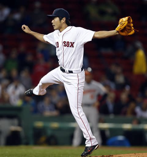 Boston Red Sox's Koji Uehara follows through on a pitch in the sixth inning of a baseball game against the Baltimore Orioles in Boston, Wednesday, April 10, 2013. (AP Photo/Michael Dwyer)