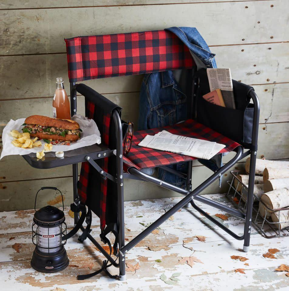 """There's a lot of action going on with this director's chair, which includes beverage pockets, an armrest caddy and a fold-out side table. <a href=""""https://yhoo.it/2AfO0GK"""" rel=""""nofollow noopener"""" target=""""_blank"""" data-ylk=""""slk:Find it for $99 at Food52"""" class=""""link rapid-noclick-resp"""">Find it for $99 at Food52</a>."""