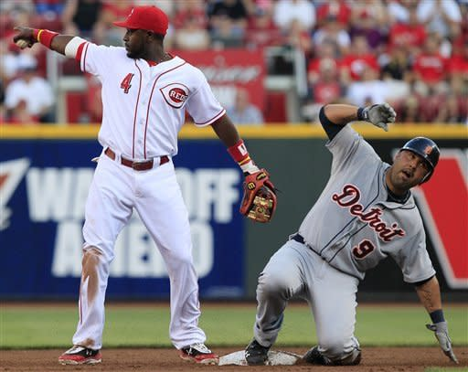 Cincinnati Reds second baseman Brandon Phillips (4) points at shortstop Zack Cozart after forcing out Detroit Tigers' Gerald Laird (9) at second base in the third inning of a baseball game, Friday, June 8, 2012, in Cincinnati. (AP Photo/Al Behrman)