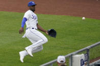 Kansas City Royals right fielder Jorge Soler chases after an RBI triple hit by Chicago White Sox's Leury Garcia during the first inning of a baseball game Saturday, May 8, 2021, in Kansas City, Mo. (AP Photo/Charlie Riedel)