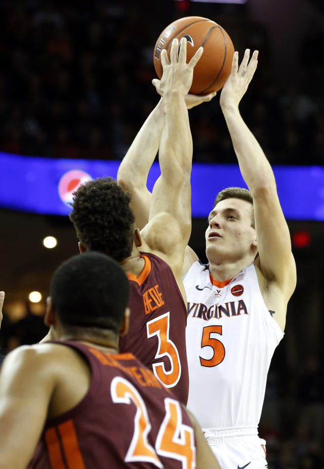 Virginia guard Kyle Guy (5) takes a shot over Virginia Tech guard Wabissa Bede (3) during the first half of an NCAA college basketball game in Charlottesville, Va., Tuesday, Jan. 15, 2019. (AP Photo/Steve Helber)