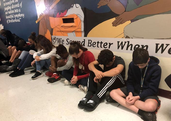 Students at Seminole Middle School in Plantation, Fla., participate in a moment of silence. (Photo: Terry Spencer/AP)