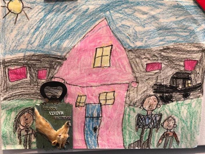 """Poorva Dixit's daughter drew a family portrait and pinned it to their refrigerator. She covered Dixit with a magnet, and said she calls the photo """"and they lived sadly ever after."""" <span class=""""copyright"""">(Poorva Dixit)</span>"""