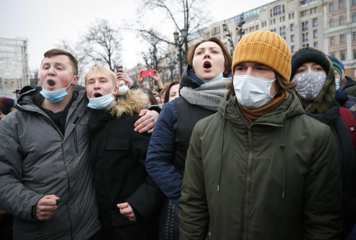 People protest against the jailing of opposition leader Alexei Navalny in Moscow, Russia, Saturday, Jan. 23, 2021. Russian police on Saturday arrested hundreds of protesters who took to the streets in temperatures as low as minus-50 C (minus-58 F) to demand the release of Alexei Navalny, the country's top opposition figure. A Navalny, President Vladimir Putin's most prominent foe, was arrested on Jan. 17 when he returned to Moscow from Germany, where he had spent five months recovering from a severe nerve-agent poisoning that he blames on the Kremlin. (AP Photo/Alexander Zemlianichenko)
