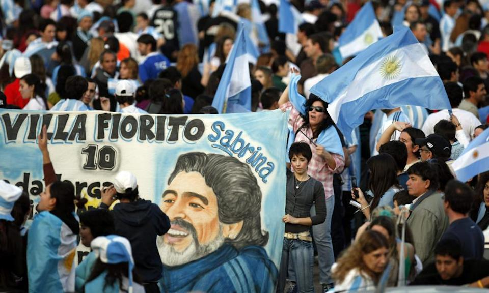 A fan holds a banner bearing a drawing of Diego Maradona in Buenos Aires, the city of his birth, in July 2010 following an Argentina game under their legendary No 10 at the 2010 World Cup in South Africa.