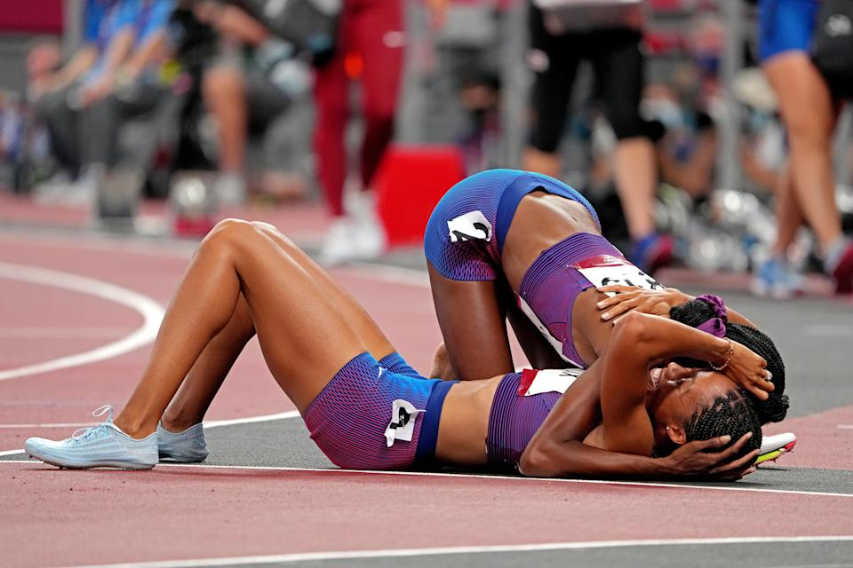 Allyson Felix (USA) celebrates winning the bronze medal with Quanera Hayes (USA) in the women's 400m final during the Tokyo 2020 Olympic Summer Games at Olympic Stadium.