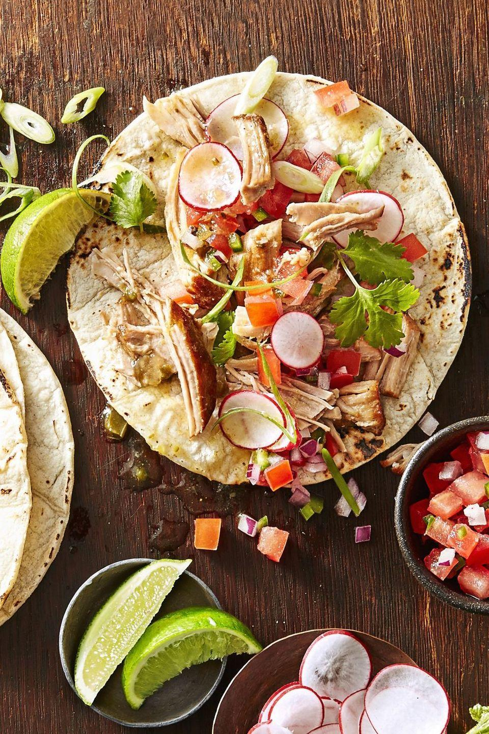 "<p>Don't worry, your slow-cooker will do the work for you in making a tender carnitas filling.</p><p><em><a href=""https://www.goodhousekeeping.com/food-recipes/a42403/carnitas-tacos-recipe/"" rel=""nofollow noopener"" target=""_blank"" data-ylk=""slk:Get the recipe for Carnitas Tacos »"" class=""link rapid-noclick-resp"">Get the recipe for Carnitas Tacos » </a></em></p>"