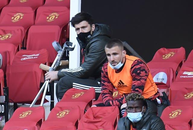 Maguier (top) watched the midweek Premier League defeat to Liverpool while using crutches.