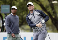 Lucas Bjerregaard, right, watches his drive on the eighth hole as Tiger Woods, left, looks on during quarterfinal play at the Dell Technologies Match Play Championship golf tournament, Saturday, March 30, 2019, in Austin, Texas. Bjerregaard won the match. (AP Photo/Eric Gay)