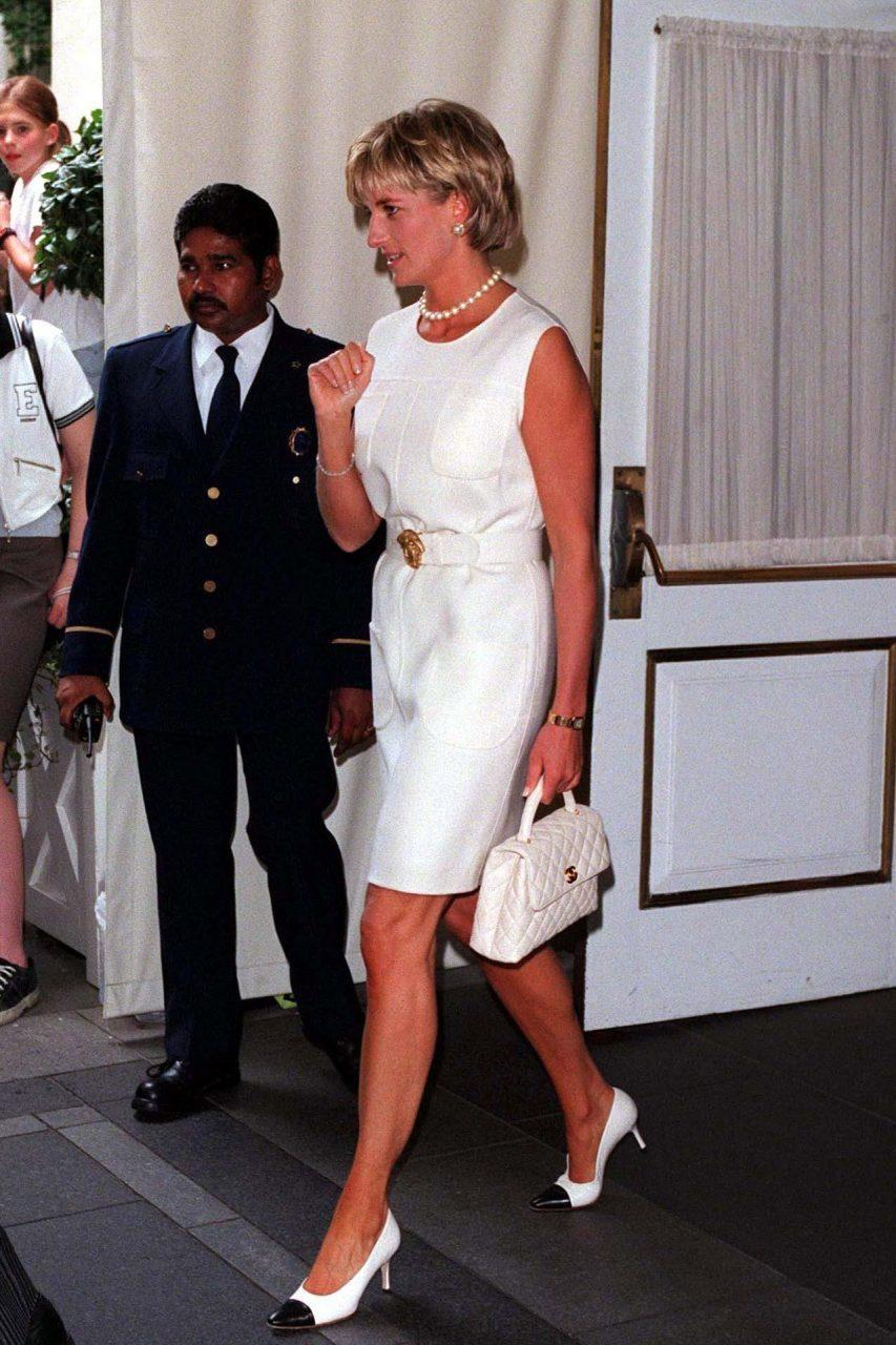 The pristine white Chanel bag bringing undeniable polish to Diana's looks in the late '90s. REX FEATURES