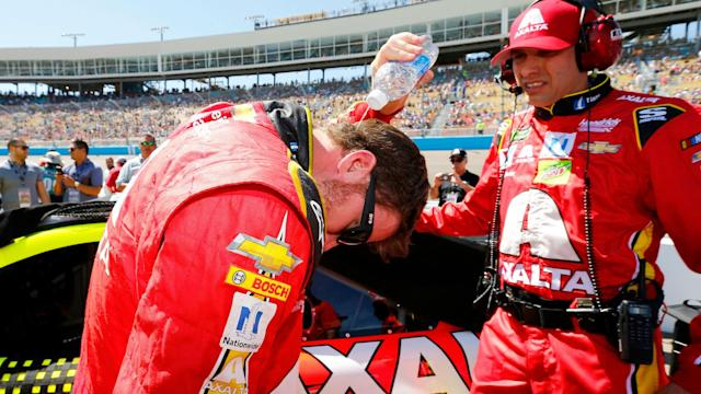 Watch Dale Earnhardt Jr. shove a bag of ice into his racing suit to survive his 144-degree car.