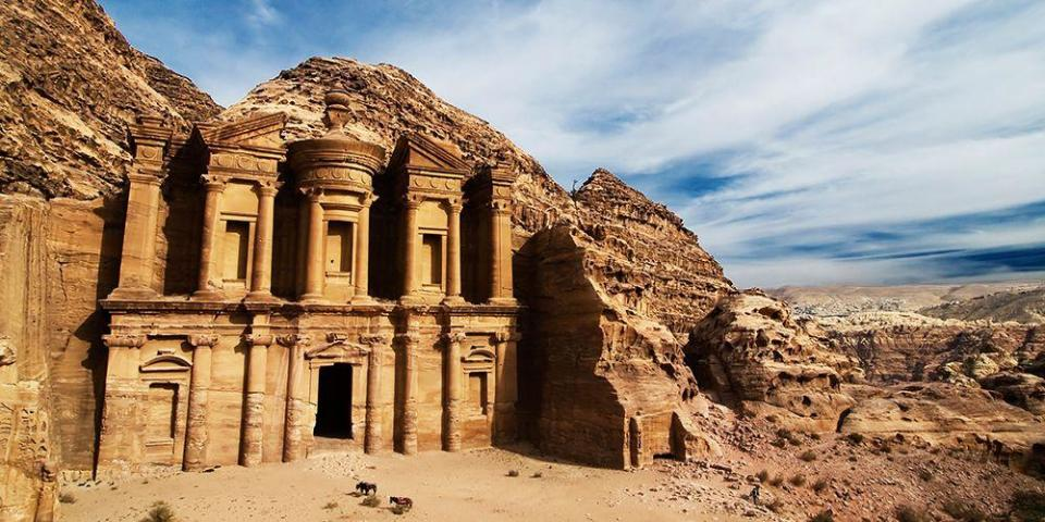"""<p>One of the world's most famous archaeological sites, Petra is a top attraction in Jordan, named one of <em>Lonely Planet</em>'s <a href=""""https://www.lonelyplanet.com/best-in-travel/countries"""" rel=""""nofollow noopener"""" target=""""_blank"""" data-ylk=""""slk:2019 must-visit countries"""" class=""""link rapid-noclick-resp"""">2019 must-visit countries</a>. </p><p>Fun fact: Several scenes from <em>Indiana Jones and the Last Crusade</em> were filmed here. The site's ancient temples and tombs are carved directly into the pink sandstone cliff faces, creating a beautiful but eerie stone tableau. It's definitely worth seeing at sunset. </p>"""