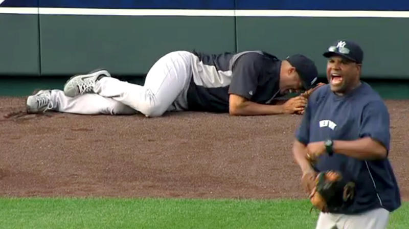 In this image taken from video, New York Yankees' Mariano Rivera, left, lies on the field after twisting his right knee shagging fly balls during batting practice before a baseball game with the Kansas City Royals, Thursday, May 3, 2012, in Kansas City, Mo. The Yankees closer was carted off the field and sent for further tests. (AP Photo/YES Network) MANDATORY CREDIT