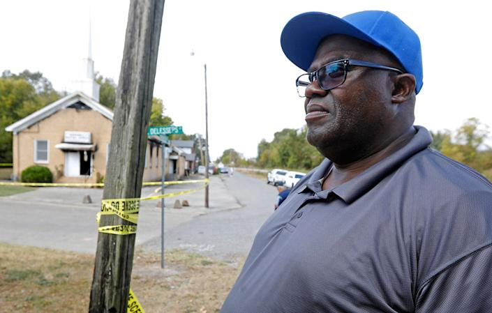 """<p>Bishop Clarence Green stands outside his fire damaged 200-member Hopewell M.B. Baptist Church in Greenville, Miss., Wednesday, Nov. 2, 2016. A Mississippi mayor is calling it a hate crime as arson investigators collect evidence at a black church that was heavily damaged by fire and tagged with """"Vote Trump"""" in silver spray paint. (AP Photo/Rogelio V. Solis) </p>"""