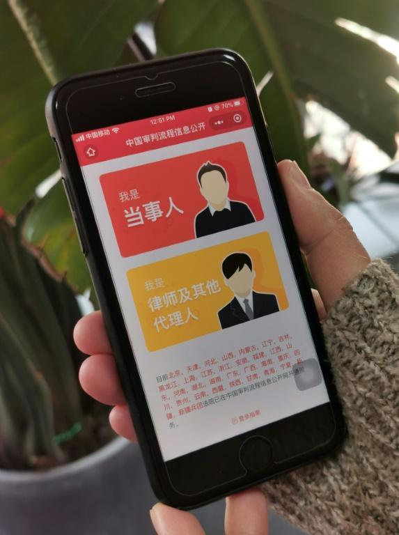 A 'mobile court' offered on popular Chinese social media platform WeChat has handled more than three million legal cases or other judicial procedures since its launch in March (AFP Photo/KELLY WANG)
