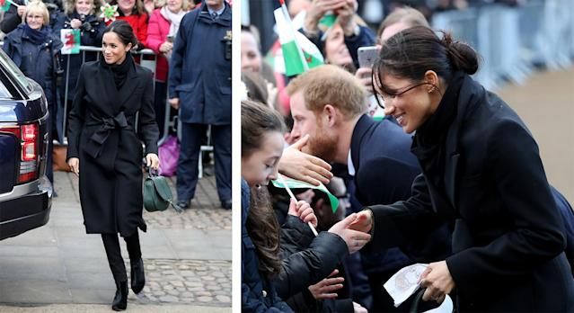 Prince Harry and Meghan Markle greet the crowds at Cardiff Castle. (Photo: Getty Images)