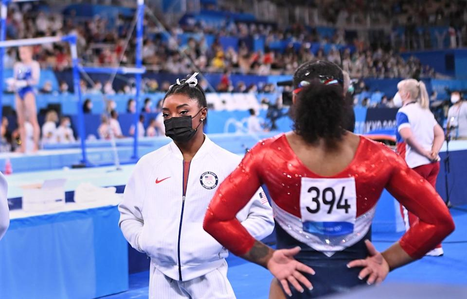Simone Biles looks on after pulling out of the women's team final Tuesday at the Tokyo Olympics.