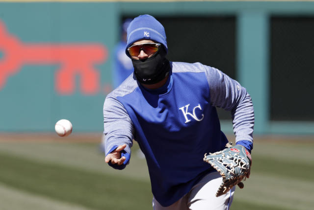 Kansas City Royals' Cheslor Cuthbert tosses the ball to first base during batting practice before a baseball game between the Kansas City Royals and the Cleveland Indians, Saturday, April 7, 2018, in Cleveland. (AP Photo/Tony Dejak)