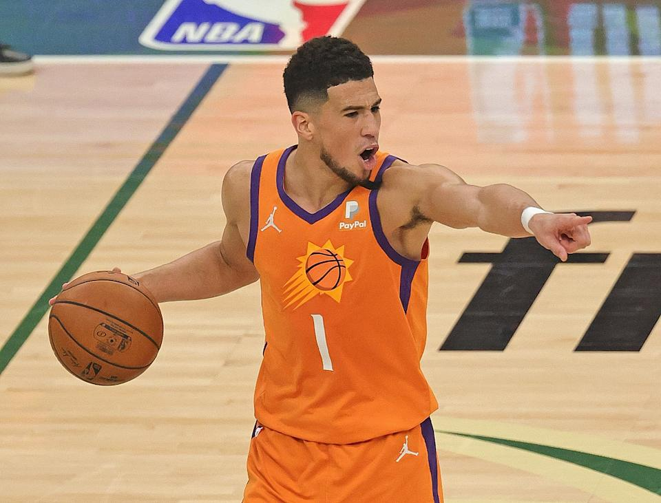 Devin Booker's standing in the league would only grow with wins in Games 6 and 7. (Jonathan Daniel/Getty Images)