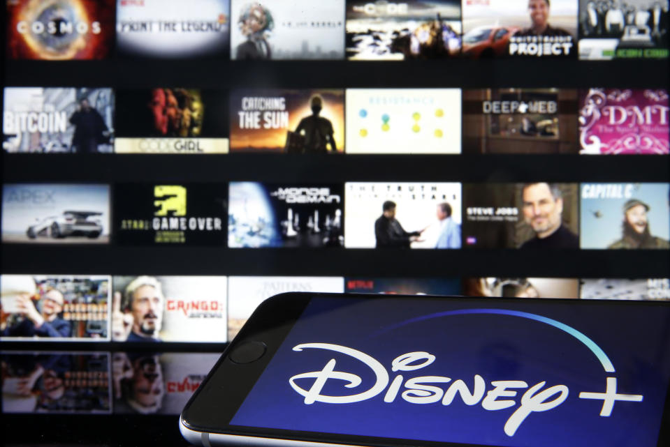PARIS, FRANCE - MARCH 28: In this photo illustration, Disney + logo is diplayed on the screen of an iPhone in front of a television screen showing a Disney + logo on March 28, 2020 in Paris, France. At the request of the French government, the Disney + streaming platform has decided to postpone its launch in France to April 7. (Photo Illustration by Chesnot/Getty Images)
