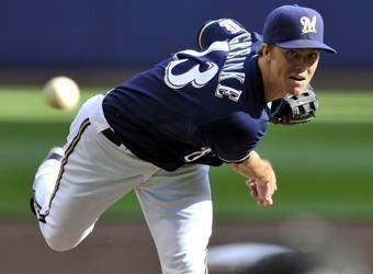 Zach Greinke delivers a pitch during the first inning of Game 1 of the NLCS against the Cardinals