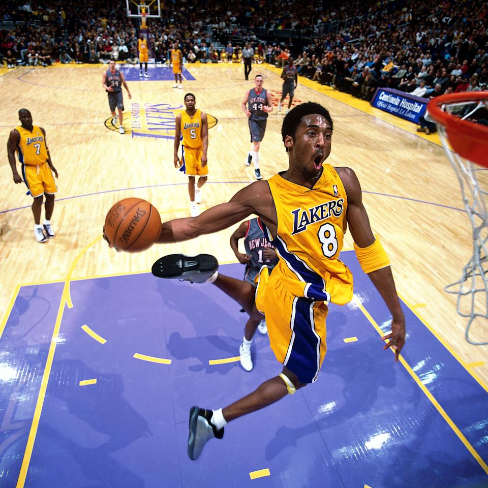 Kobe Bryant's talent was fast approaching his confidence as the ceiling lifted on the possibilities for his career in 2001. Here he began the New Year with a jaw-dropping dunk. (Andrew D. Bernstein/NBAE via Getty Images)