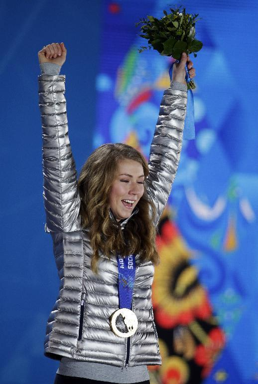 Women's slalom gold medalist Mikaela Shiffrin of the United States celebrates during the medals ceremony at the 2014 Winter Olympics, Saturday, Feb. 22, 2014, in Sochi, Russia. (AP Photo/Darron Cummings)