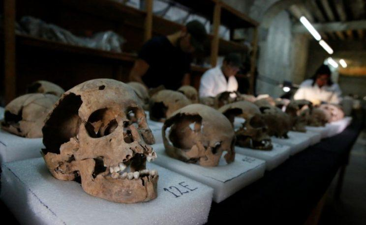 Biological anthropologists examine skulls discovered in the cylindrical edifice near Templo Mayor (Reuters)