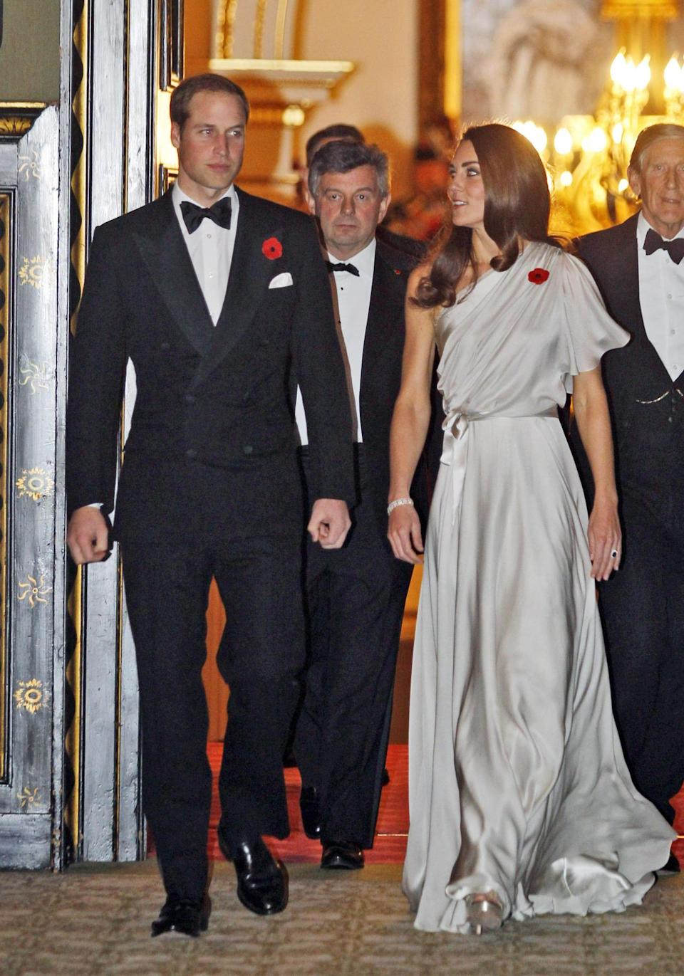 <p>At a charity dinner, Kate was seen in a one-shouldered silver Jenny Packham gown with Jimmy Choo platform sandals. </p><p><i>[Photo: PA]</i></p>