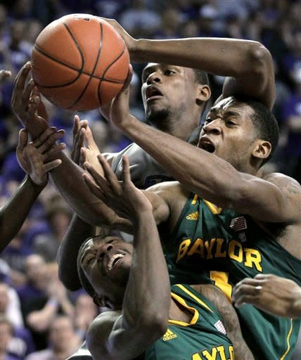 Kansas State center Jordan Henriquez, back, and Baylor's Perry Jones III, center, and guard A.J. Walton (22) compete for a rebound during the first half of an NCAA college basketball game Tuesday, Jan. 10, 2012, in Manhattan, Kan. (AP Photo/Charlie Riedel)