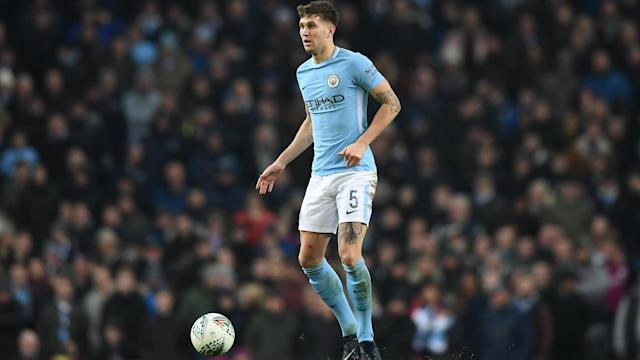 The chase for four trophies this season could slow Manchester City down, according to defender John Stones.