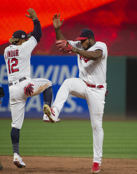 Cleveland Indians' Francisco Lindor and Yasiel Puig celebrate a 10-1 win over the Philadelphia Phillies at a baseball game in Cleveland, Sunday, Sept. 22, 2019. (AP Photo/Phil Long)