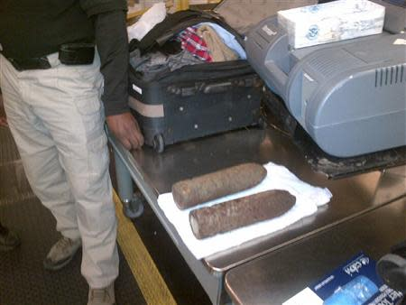 U.S. Transportation Security Administration (TSA) photo shows two military-grade shells in checked baggage at Chicago O'Hare International Airport on April 7, 2014 and released on April 8, 2014. REUTERS/TSA/Handout via Reuters