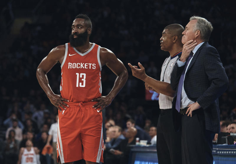 FILE - In this Oct. 9, 2017, file photo, Houston Rockets' James Harden (13) and coach Mike D'Antoni talk to a referee during the first half of a preseason NBA basketball game at Madison Square Garden in New York. (AP Photo/Andres Kudacki, File)