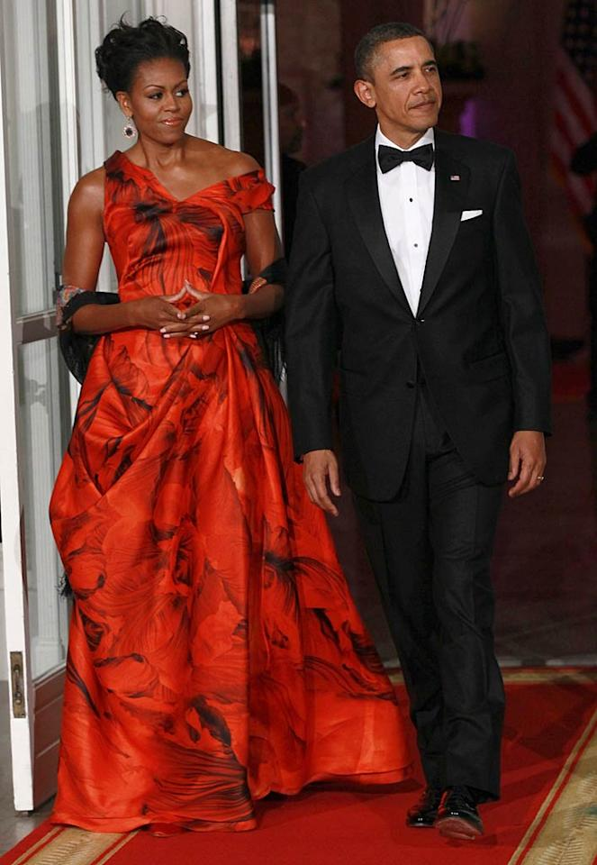 """Goosebumps, anyone? We certainly got 'em when we saw Michelle Obama in the Alexander McQueen masterpiece she wore while hosting a State dinner for Chinese President Hu Jintao alongside her hubby, Barack. Without a doubt, Michelle is the most fashionable First Lady since Jackie O. Win McNamee/<a href=""""http://www.gettyimages.com/"""" target=""""new"""">GettyImages.com</a> - January 19, 2011"""