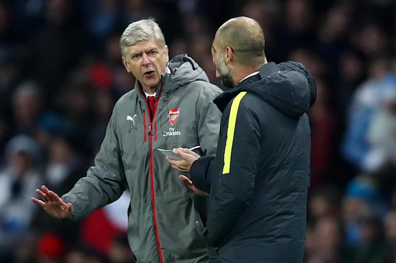 Silverware: Wenger and Guardiola will meet in Sunday's EFL Cup final: Getty Images