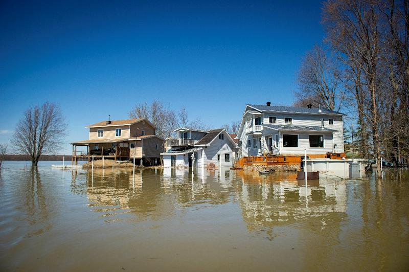 Floods in progress at Rigaud in the suburbs of Montreal, Quebec, Canada on Monday, April 22, 2019 (AFP Photo/Sebastien St-Jean)