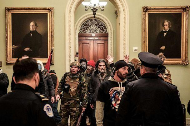 PHOTO: Robert Gieswein, left, in military garb, and Dominic Pezzola, center right, with a gray beard, confront Capitol Police officers at the U.S. Capitol in Washington on Jan. 6, 2021. (Erin Schaff/The New York Times/Redux Pictures)