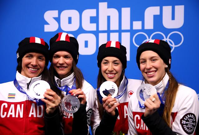 SOCHI, RUSSIA - FEBRUARY 18: Silver medalists (L-R) Marie-Eve Drolet, Jessica Hewitt, Valerie Maltais and Marianne St. Gelais of Canada celebrate on the podium during the medal ceremony for the Short Track Ladies' 3000m Relay on day ten of the Sochi 2014 Winter Olympics at Medals Plaza on February 18, 2014 in Sochi, Russia. (Photo by Paul Gilham/Getty Images)