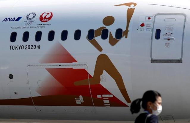 FILE PHOTO: 'Tokyo 2020 Go' aircraft leaves Tokyo's Haneda airport for Greece to collect the Olympic Flame, ahead of torch relay