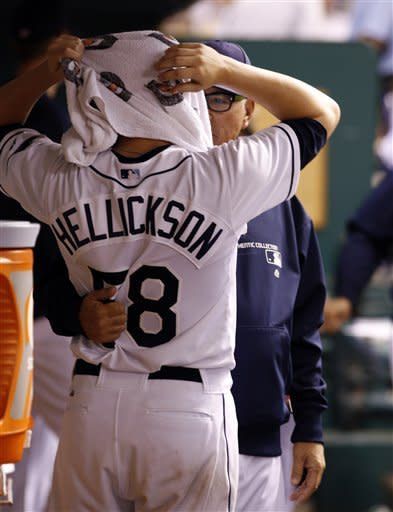 Tampa Bay Rays manager Joe Madden talks with starting pitcher Jeremy Hellickson after pulling him in the fourth inning against the Oakland Athletics during a baseball game, Saturday, May 5, 2012, in St. Petersburg, Fla. (AP Photo/Scott Iskowitz)