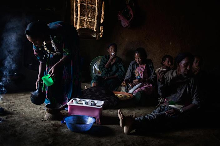 <p>The women of the family drink coffee after lunch at Abaynesh in-laws in Gindero, Amhara Ethiopia in October 2016. They usually eat when the men have finished. On the right, sits Abaynesh's mother-in-law. Her sister-in-law (23) holds her third baby. Abaynesh's little sister (12) is sitting in the back. (Photo: José Colón/MeMo) </p>